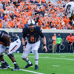 Oklahoma State quarterback Mason Rudolph shouts an audible to his team as they attempt and fail to tie the score at 28 apiece with a two point conversion following their touchdown in the thi ...