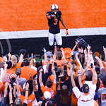 Oklahoma State wide receiver Marcell Ateman salutes the crowd following his 11-yard touchdown catch with 46 seconds remaining in the first half of the Wildcats' heartbreaking 34-36 loss to N ...