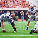 Senior wide receiver-turned-improptu quarterback Kody Cook lines up behind center in place of junior quarterback Joe Hubener, who was injured after less than two minutes of gametime, in the  ...