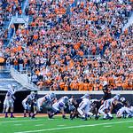 Crowd noise bears down on the Wildcat offense as they attempt to stage a touchdown drive starting deep in their own territory to take the lead back from Oklahoma State with about six minutes ...