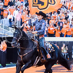 An Oklahoma State Cowgirl speeds around the field atop Bullet the horse after Oklahoma State scores a touchdown to take a 33-28 lead with about six minutes remaining in the Wildcats' heartbr ...