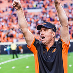 Oklahoma State head coach Mike Gundy salutes the OSU student section for their rambunctious support during the Cowboys' 36-34 clutch last-minute win over K-State Oct. 3, 2015, in Boone Picke ...