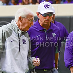 Head coach Bill Snyder talks with son and Associate Head Coach Sean Snyder as the Wildcats head into the locker room prior to the Wildcats' Big 12 matchup against No. 20-ranked Oklahoma Stat ...
