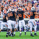 Oklahoma State players celebrate with kicker Ben Grogan (in the mob) after he nailed a 37-yard field goal to give the Cowboys the 36-34 edge with 0:35 remaining in the fourth quarter of the  ...