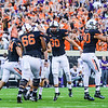 Oklahoma State players celebrate with kicker Ben Grogan (in the mob) after he nailed a 37-yard field goal to give the Cowboys the 36-34 edge with 0:35 remaining in the fourth quarter of the Wildcats' heartbreaking 34-36 loss to No. 20-ranked Oklahoma State Oct. 3, 2015, in Boone Pickens Stadium in Stillwater, Oklahoma. (Parker Robb | The Collegian)