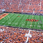 Thousands of orange-clad Oklahoma State fans fill Boone Pickens Stadium in Stillwater, Oklahoma, to watch the No. 20-ranked Cowboys take on the Kansas State Wildcats Oct. 3, 2015. (Parker Ro ...