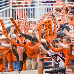 Oklahoma State students bang their paddles against the field wall padding after K-State linebacker Will Davis intercepted Oklahoma State quarterback Mason Rudolph's pass early in the fourth  ...