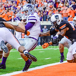 Junior quarterback Joe Hubener falls into the endzone as Oklahoma State defenders attempt to counteract gravity late in the fourth quarter of the Wildcats' heartbreaking 34-36 loss to No. 20 ...