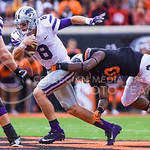 Senior quarterback Joe Hubener (8) tries unsuccessfully to evade the Oklahoma State defense as he is sacked by OSU linebacker Devante Averette (40) for a fourteen yard loss as K-State holds  ...