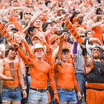 Oklahoma State fans donning painted chests raise their wooden paddles following an Oklahoma State touchdown in the second quarter of the Wildcats' heartbreaking 34-36 loss to the No. 20-rank ...