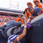Willie signs the cast of a K-State fan during halftime of the Wildcats' heartbreaking 34-36 loss to No. 20-ranked Oklahoma State Oct. 3, 2015, in Boone Pickens Stadium in Stillwater, Oklahom ...