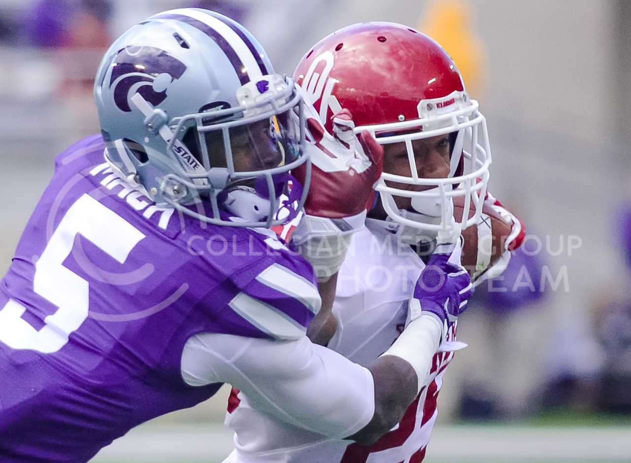 Oklahoma runningback Joe Mixon pushes K-State junior defensive back Jesse Mack aside as he rushes for 11 yards to the 1 yard line as the Sooners continue to advance down the field to their sixth and final touchdown in the fourth quarter of the Wildcats' 55-0 shutout loss to the No. 19 Oklahoma Sooners Oct. 17, 2015, in Bill Snyder Family Stadium. (Parker Robb | The Collegian)