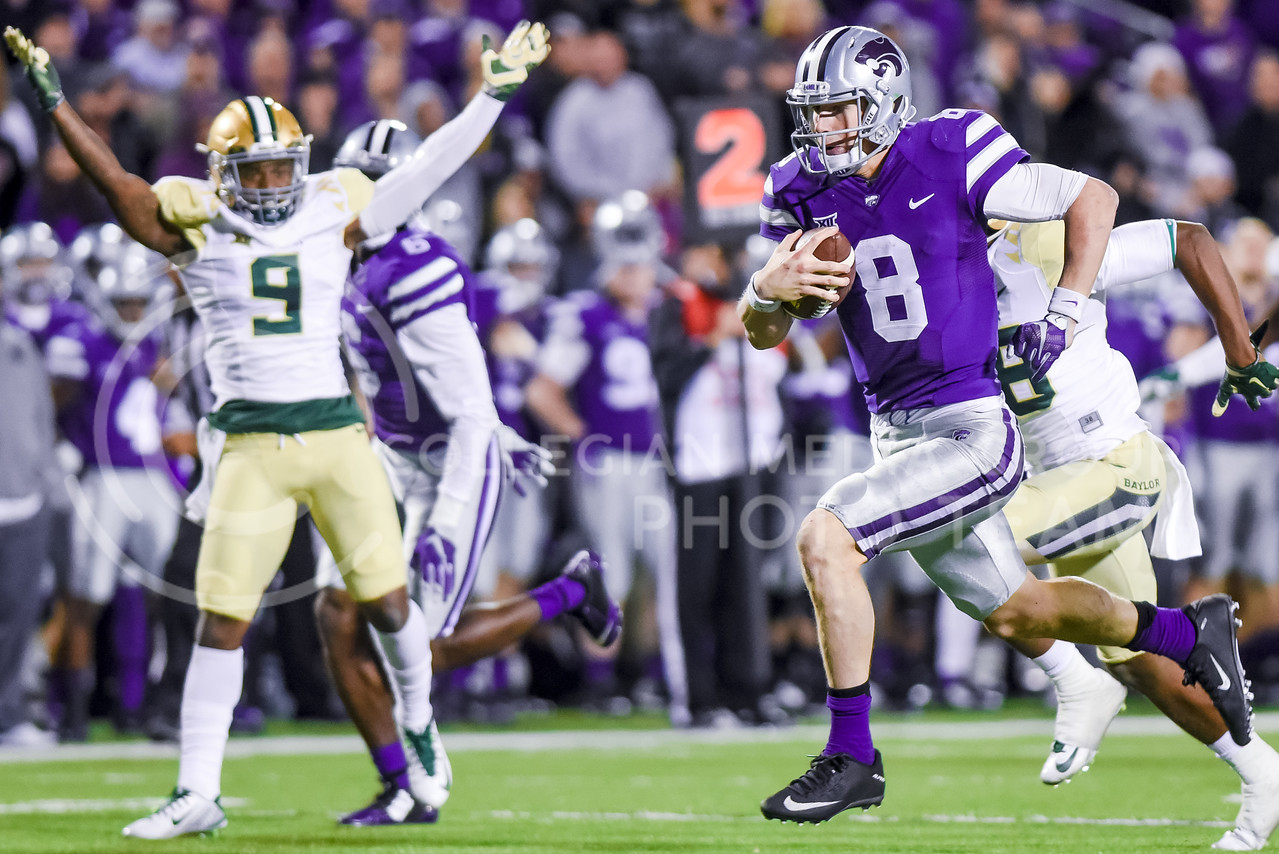 Baylor defensive back Ryan Reid throws up his arms in despair as junior quarterback Joe Hubener takes off on a 34-yard touchdown run to cut the Bears' lead to 31-17 as K-State attempts a comeback in the fourth quarter of the Wildcats' 24-31 loss to the No. 2 Bears Nov. 5, 2015, in Bill Snyder Family Stadium. Hubener rushed for 153 yards and two touchdowns against the Bears. (Parker Robb | The Collegian)