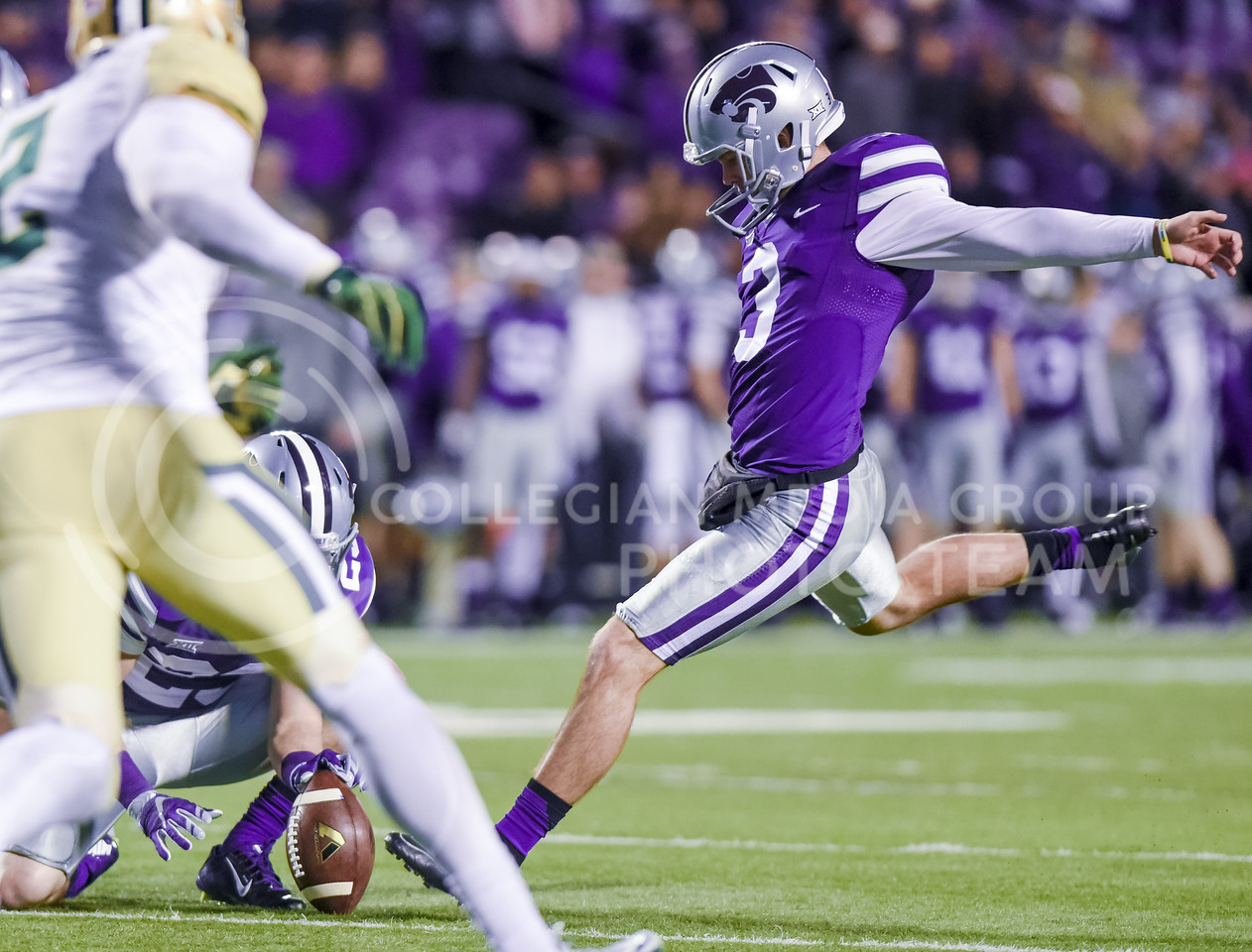 Senior kicker Jack Cantele puts in the extra point after Joe Hubener's touchdown run in the fourth quarter of the Wildcats' 24-31 loss to the No. 2 Bears Nov. 5, 2015, in Bill Snyder Family Stadium. (Parker Robb | The Collegian)