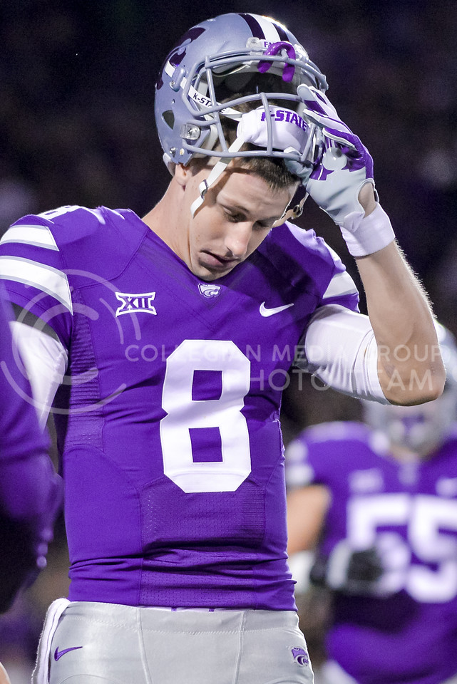 Junior quarterback Joe Hubener hangs his head at having to burn a precious timeout before K-State's first offensive play of the game early in the first quarter of the Wildcats' 24-31 loss to the No. 2 Bears Nov. 5, 2015, in Bill Snyder Family Stadium. (Parker Robb | The Collegian)