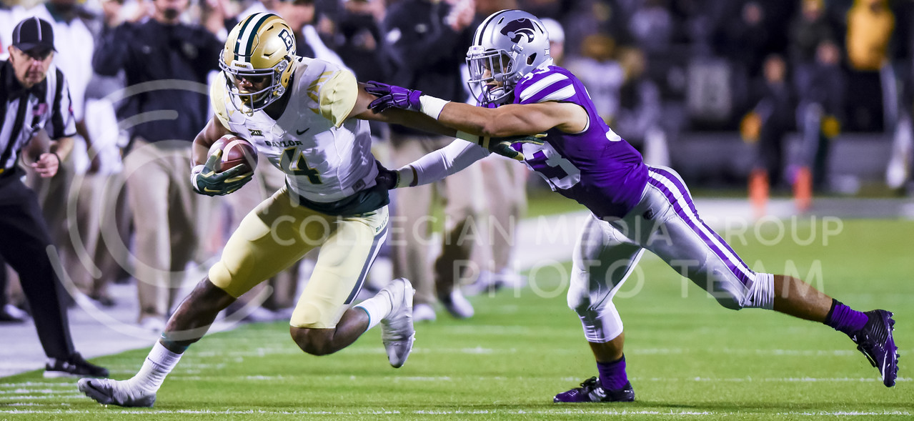 Baylor wide receiver Jay Lee blazes past senior defensive back Morgan Burns as he rushes down the sideline after a catch as Baylor attempts to add to its 24-10 lead early in the fourth quarter of the Wildcats' 24-31 loss to the No. 2 Bears Nov. 5, 2015, in Bill Snyder Family Stadium. (Parker Robb | The Collegian)