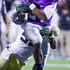 Junior runningback Charles Jones attempts to escape the clutches of a Baylor defender as K-State presses on toward another touchdown late in the fourth quarter of the Wildcats' 24-31 loss to the No. 2 Bears Nov. 5, 2015, in Bill Snyder Family Stadium. (Parker Robb | The Collegian)