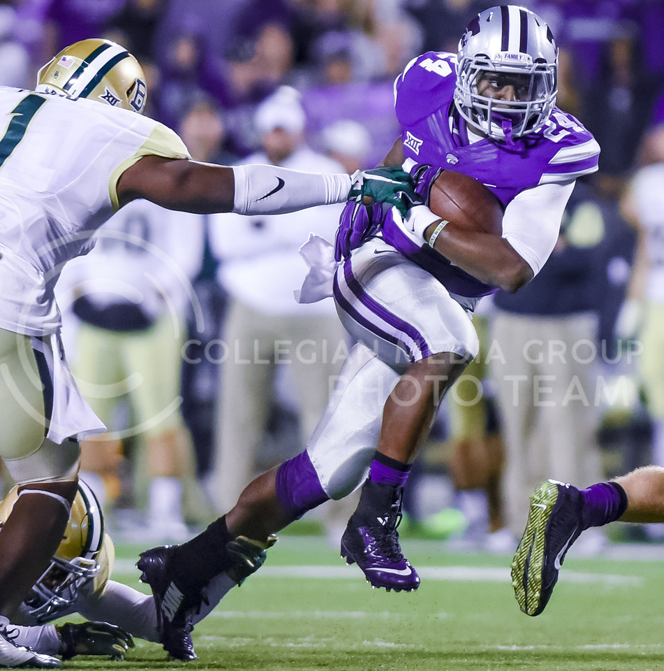 Junior runningback Charles Jones sneaks past  a few Baylor defenders en route to a 12 yard run on K-State's first possession in the first quarter of the Wildcats' 24-31 loss to the No. 2 Bears Nov. 5, 2015, in Bill Snyder Family Stadium. (Parker Robb | The Collegian)