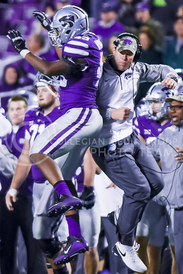 Senior defensive end Marquel Bryant bodyslams assistant defensive coach Ross Metheny midair after a missed Baylor field goal leaves K-State, down 31-24, with a chance to tie the game with about a minute left in the fourth quarter of the Wildcats' 24-31 loss to the No. 2 Bears Nov. 5, 2015, in Bill Snyder Family Stadium. (Parker Robb | The Collegian)