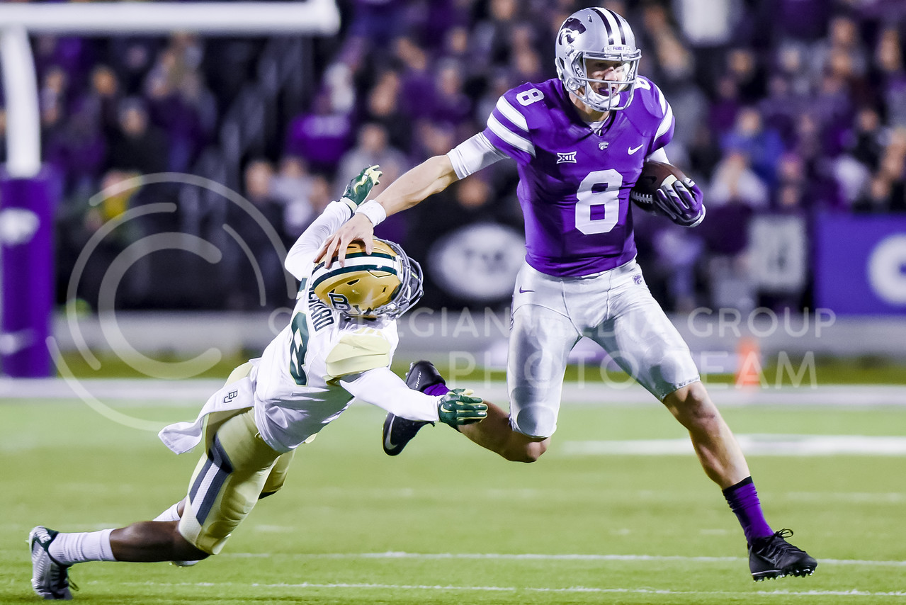 Junior quarterback Joe Hubener pushes Baylor defender Travon Blanchard aside as he rushes for 13 yards late in the second quarter of the Wildcats' 24-31 loss to the No. 2 Bears Nov. 5, 2015, in Bill Snyder Family Stadium. The Wildcats' attempt to eat into Baylor's 21-7 lead before halftime failed due to several penalties and a sack on 4th-and-18 as time expired. (Parker Robb | The Collegian)