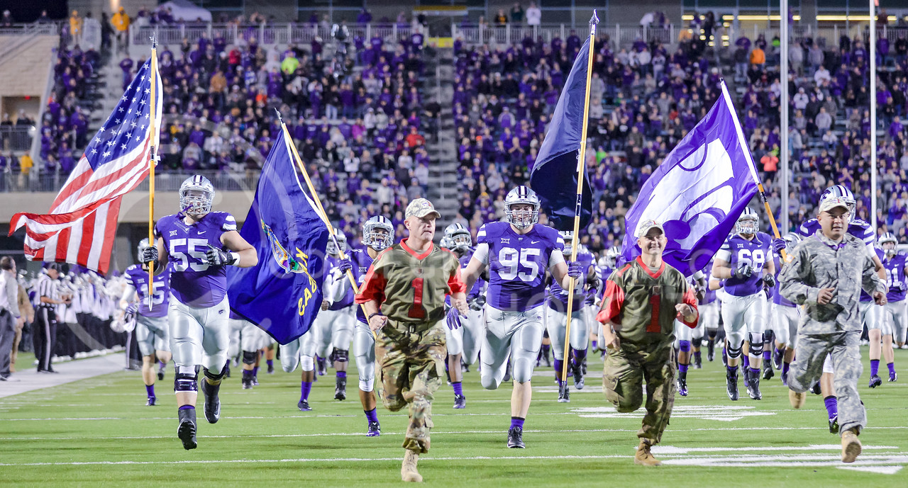 Fort Riley soldiers run onto the field alongside the Wildcats prior to K-State's matchup against No. 6 Baylor Nov. 5, 2015, in Bill Snyder Family Stadium. (Parker Robb | The Collegian)