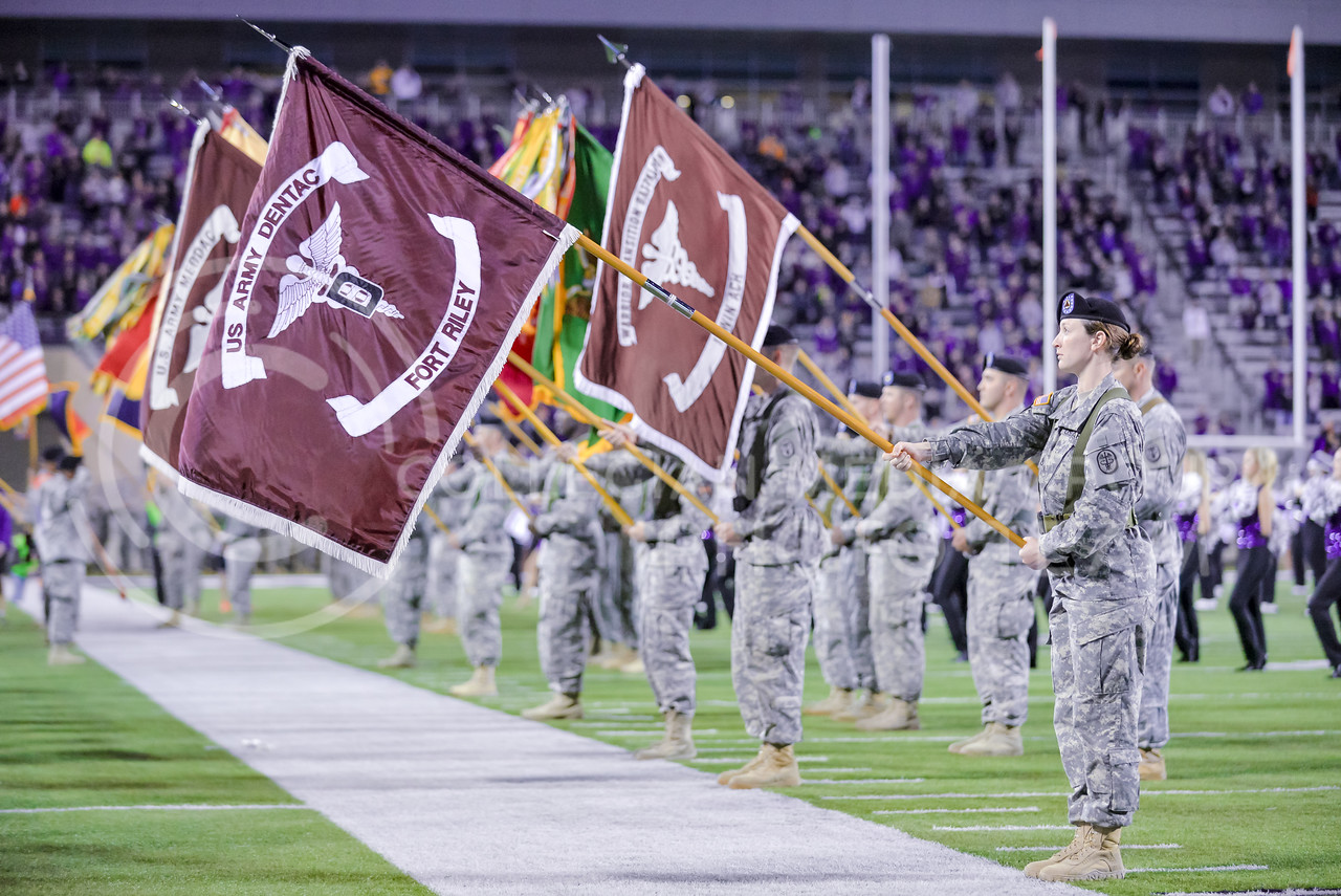 Fort Riley soldiers display the colors of military units stationed at Fort Riley alongside the American flag during the Star Spangled Banner during Fort Riley Day festivities prior to K-State's matchup against No. 6 Baylor Nov. 5, 2015, in Bill Snyder Family Stadium. (Parker Robb | The Collegian)