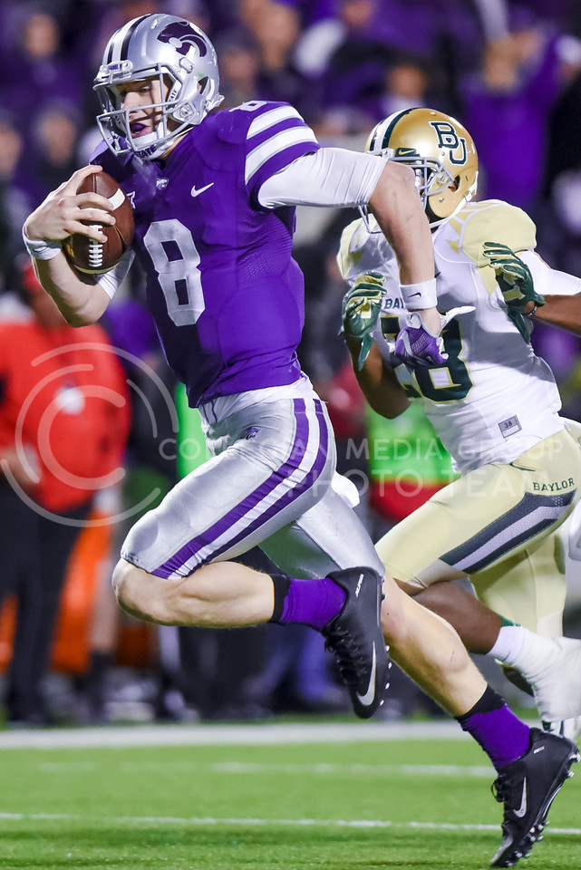 Junior quarterback Joe Hubener takes off on a 34-yard touchdown run to cut the Bears' lead to 31-17 as K-State attempts a comeback in the fourth quarter of the Wildcats' 24-31 loss to the No. 2 Bears Nov. 5, 2015, in Bill Snyder Family Stadium. Hubener rushed for 153 yards and two touchdowns against the Bears. (Parker Robb | The Collegian)