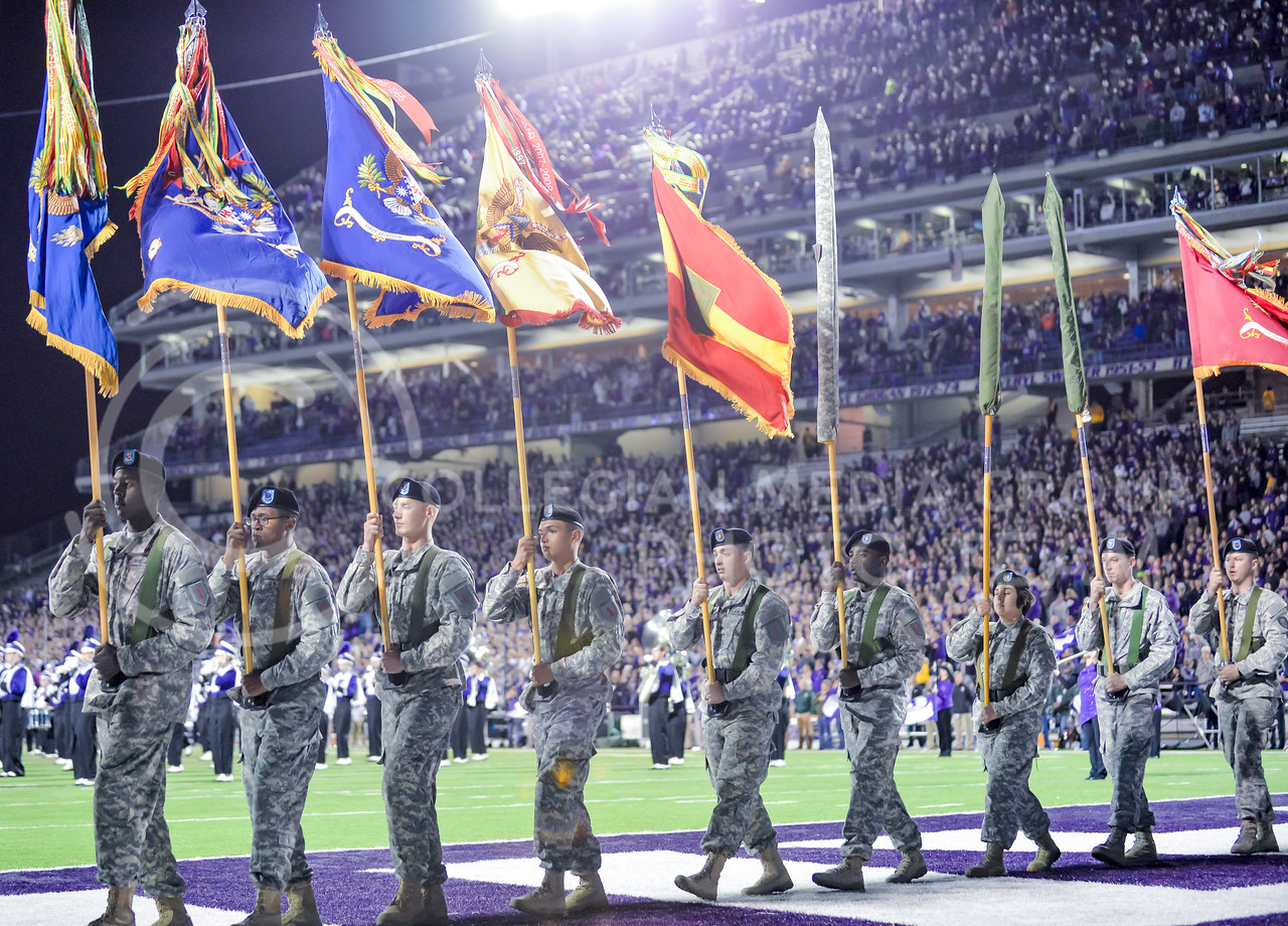 Fort Riley soldiers bearing flags march onto the field for the Fort Riley Day festivities prior to K-State's matchup against No. 6 Baylor Nov. 5, 2015, in Bill Snyder Family Stadium. (Parker Robb | The Collegian)