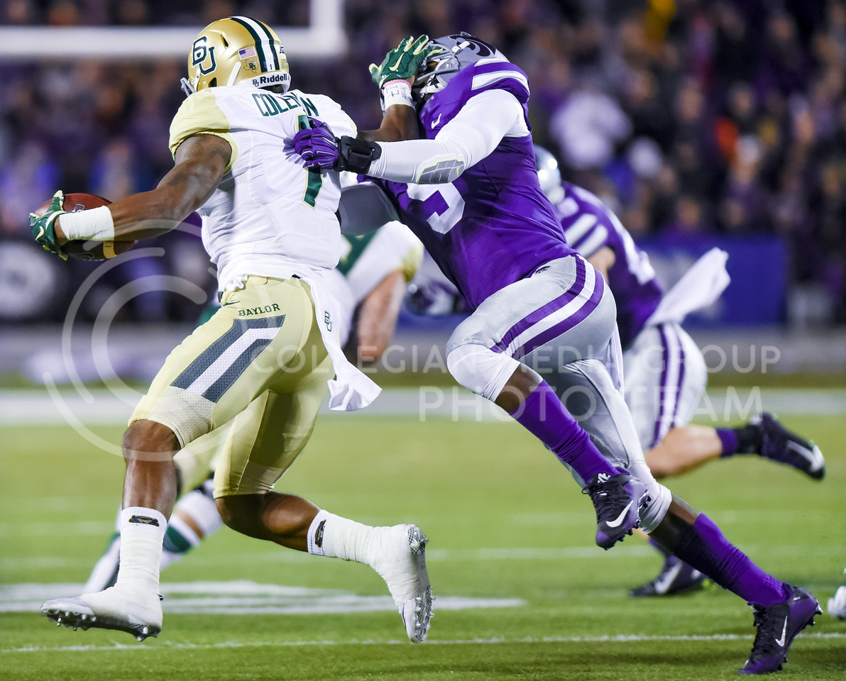 Baylor wide receiver Corey Coleman pushes sophomore linebacker Elijah Lee aside as he sprints ahead for 15 yards in the second quarter of the Wildcats' 24-31 loss to the No. 2 Bears Nov. 5, 2015, in Bill Snyder Family Stadium. (Parker Robb | The Collegian)