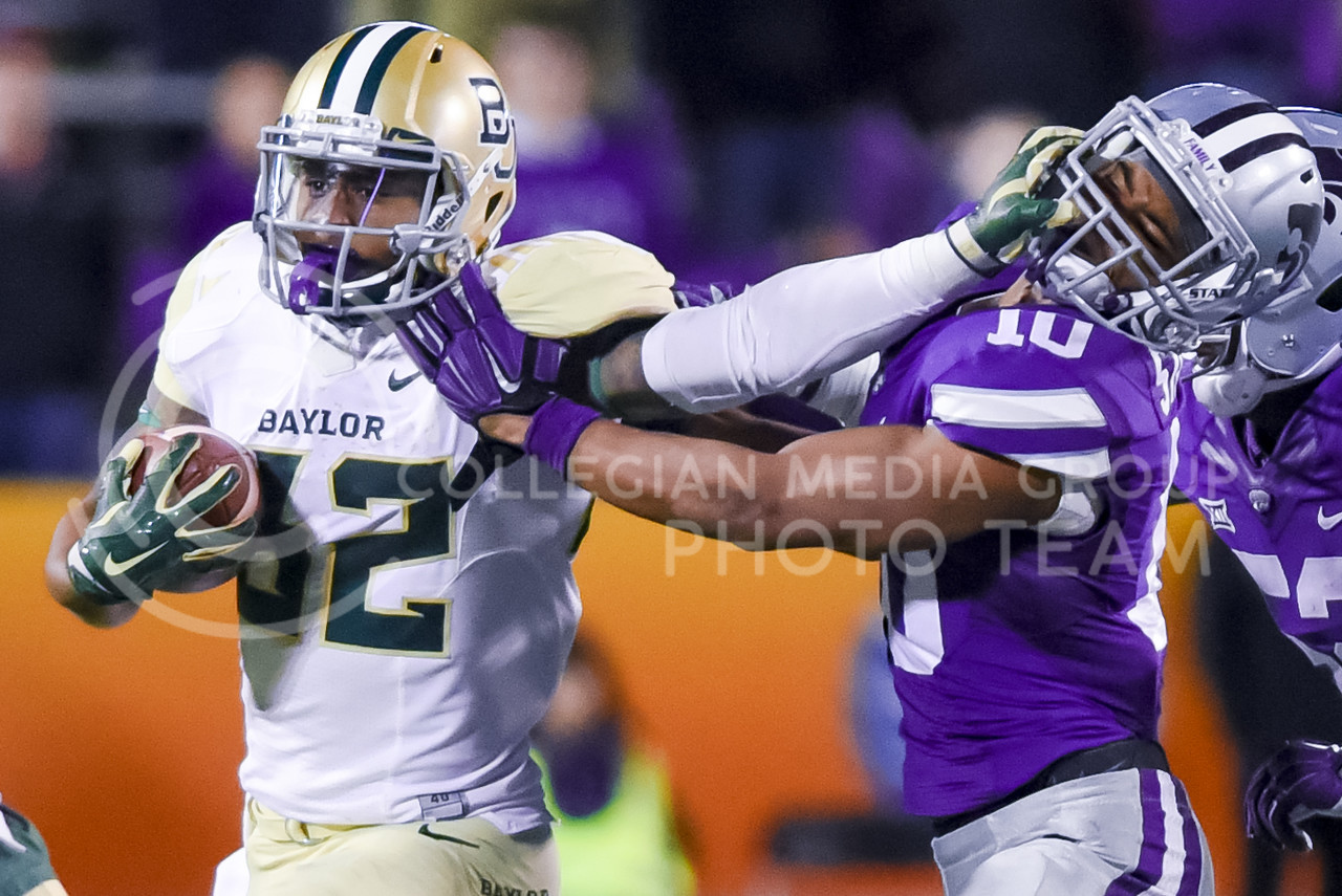 (Parker Robb | The CollegianBaylor runningback Shock Linwood stiff-arms junior defensive back Donnie Starks as he rushes in the fourth quarter of the Wildcats' 24-31 loss to the No. 2 Bears Nov. 5, 2015, in Bill Snyder Family Stadium. Hubener rushed for 153 yards and two touchdowns against the Bears. (Parker Robb | The Collegian)