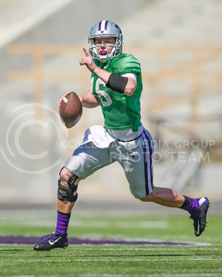Junior quarterback Jesse Ertz looks downfield for open receivers in the fourth quarter of the annual Purple-White Spring Game Apr. 23, 2016, in Bill Snyder Family Stadium. The Purple team beat the White team 35-21. (Parker Robb | The Collegian)