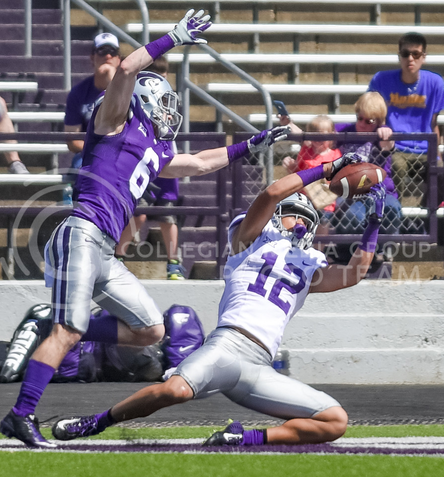 Freshman wide receiver Corey Sutton brings down a 33-yard touchdown pass from senior quarterback Joe Hubener in the fourth quarter of the annual Purple-White Spring Game Apr. 23, 2016, in Bill Snyder Family Stadium. The Purple team beat the White team 35-21. (Parker Robb | The Collegian)