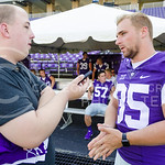 The Collegian's Tim Everson speaks with junior linebacker Will Davis at K-State Football's media day August 8, 2015. (Parker Robb | The Collegian)