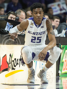 Junior forward Wesley Iwundu patiently waits to be subbed in the game against Texas on Feb. 22, 2016 in Bramlage Coliseum.  The heart wrenching 71-70 loss against the Longhorns put the crowd on their feet, and took the players to their knees.  (Rodney Dimick | The Collegian)