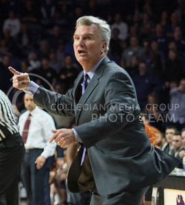 Head coach Bruce Weber attempts to convince the referees that the possession of the ball belongs to the Wildcats on Feb. 22, 2016 in Bramlage Coliseum.  Despite Weber's efforts, Texas was granted ownership of the ball.  (Rodney Dimick | The Collegian)