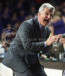 Head coach Bruce Weber talks with his coaching staff during the game against Texas on Feb. 22, 2016 in Bramlage Coliseum.  Weber's excitement represted most everyone's feelings regarding the gut wrenching loss to the Longhorns.  (Rodney Dimick | The Collegian)