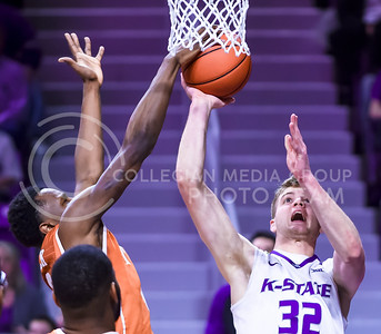 Texas guard Tevin Mack blocks K-State freshman forward Dean Wade's shot as Wade attempts a layup in the second half of the Wildcats' 71-70 loss to the No. 25 Longhorns Feb. 22, 2016, in Bramlage Coliseum. (Parker Robb | The Collegian)