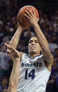 Senior guard Justin Edwards reaches toward the goal on Feb. 22, 2016 in Bramlage Coliseum.  Edwards brought in a whopping 20 points in the battle against Texas.  (Rodney Dimick | The Collegian)