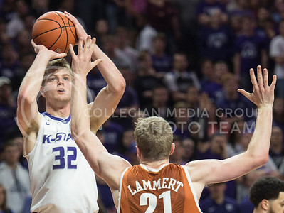 Freshman forward Dean Wade steps beyond the arc to shoot an unsuccessful three-point shot on Feb. 22, 2016 in Bramlage Coliseum.  Wade had three rebounds and four assists in the game against Texas.  (Rodney Dimick | The Collegian)