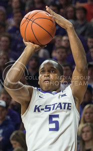 Freshman guard Barry Brown looks toward the basket as he shoots on Dec. 9, 2015 at Bramlage Coliseum.  Brown sunk three 3-point shots in the game against Coppin State.  (Rodney Dimick | The Collegian)