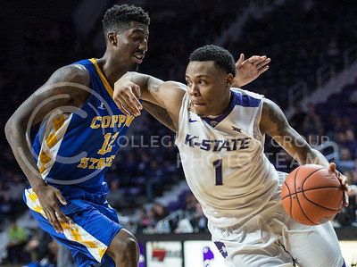 Junior guard Carlbe Ervin II maneuvers around Coppin State University junior forward Terry Harris, Jr on Dec. 9, 2015 at Bramlage Coliseum.  Coppin State was not able to keep up with K-State and lost 83-58.  (Rodney Dimick | The Collegian)