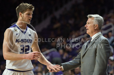 Head coach Bruce Weber welcomes freshman forward Dean Wade to the bench on Dec. 9, 2015 at Bramlage Coliseum.  Wade brought in a total of 14 points and seven rebounds in the game against Coppin State University.  (Rodney Dimick | The Collegian)