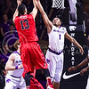 Junior guard Carlbe Ervin II (1) attempts to block a shot from Ole Miss forward Anthony Perez in the second half of the Wildcats' 69-64 win over the Rebels in the teams' Big 12-SEC Challenge game Jan. 30, 2016, in Bramlage Coliseum. (Parker Robb | The Collegian)