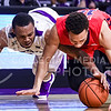Junior guard Carlbe Ervin II (white) and Ole Miss guard Sam Finley lunge for a loose ball in the second half of the Wildcats' 69-64 win over the Rebels in the teams' Big 12-SEC Challenge game Jan. 30, 2016, in Bramlage Coliseum. (Parker Robb | The Collegian)