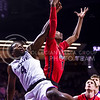 Senior forward D.J. Johnson (4) reaches for a rebound as he stumbles behind Ole Miss guard Rasheed Brooks in the second half of the Wildcats' 69-64 win over the Rebels in the teams' Big 12-SEC Challenge game Jan. 30, 2016, in Bramlage Coliseum. (Parker Robb | The Collegian)
