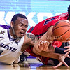 Junior guard Carlbe Ervin II (1) struggles with Ole Miss guard Sam Finley for a loose ball in the second half of the Wildcats' 69-64 win over the Rebels in the teams' Big 12-SEC Challenge game Jan. 30, 2016, in Bramlage Coliseum. (Parker Robb | The Collegian)