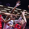 Senior forward Stephen Hurt (white) reaches into Ole Miss forward Jake Coddington's (right) space to attempt to intercept a pass from Ole Miss forward Anthony Perez (left) in the second half of the Wildcats' 69-64 win over the Rebels in the teams' Big 12-SEC Challenge game Jan. 30, 2016, in Bramlage Coliseum. (Parker Robb | The Collegian)
