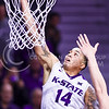 Senior forward Justin Edwards gets a layup in the second half of the Wildcats' 69-64 win over the Rebels in the teams' Big 12-SEC Challenge game Jan. 30, 2016, in Bramlage Coliseum. (Parker Robb | The Collegian)