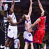 Ole Miss forward Antohy Perez (red) attempts to put a jumper in over the heads of K-State junior forward Austin Budke (middle) and senior forward D.J. Johnson in the second half of the Wildcats' 69-64 win over the Rebels in the teams' Big 12-SEC Challenge game Jan. 30, 2016, in Bramlage Coliseum. (Parker Robb | The Collegian)