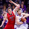 Junior forward Austin Budke snatches a rebound from Ole Miss forward Tomasz Gielo (12) in the second half of the Wildcats' 69-64 win over the Rebels in the teams' Big 12-SEC Challenge game Jan. 30, 2016, in Bramlage Coliseum. (Parker Robb | The Collegian)